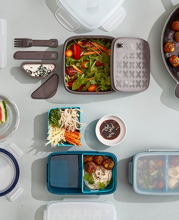 Looking for lunch containers? IKEA has a wide variety including grey plastic BLANDNING lunch box for salad with a removable dressing container, a knife, a fork and a spot for bread under the lid. It's dishwasher safe, too.