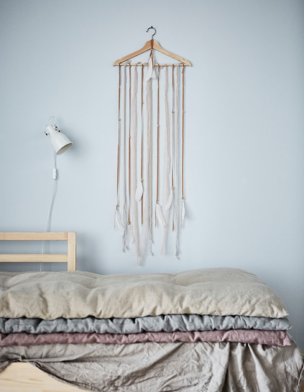 Looking for new deaco ideas? Make a DIY hanger display! IKEA has a lot of clothes hangers such as the BUMERANG wooden hanger made from solid hardwood that's renewable too. Add strips of feathers to add a personal touch to any room.