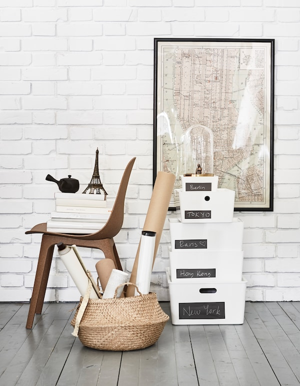 Looking for unique furniture? IKEA offers a lot of modern furniture online where you also can find home décor ideas. Use a chair to display city guides and store travel souvenirs in a couple of IKEA KUGGIS storage boxes with lids on the floor.