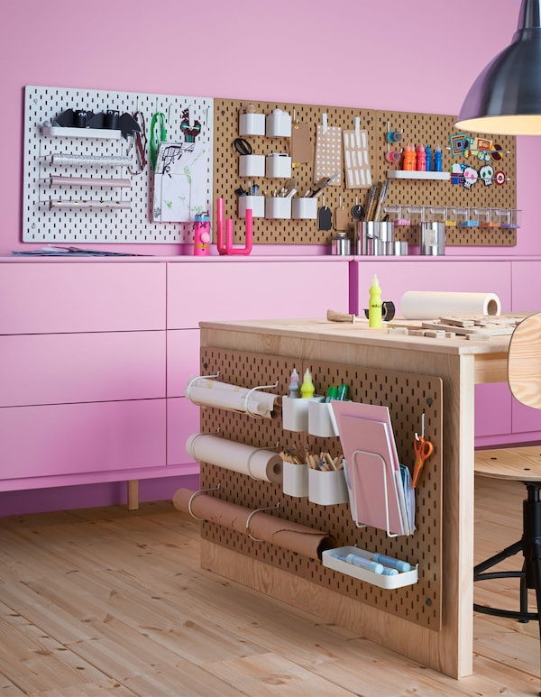 Lots of SKÅDIS pegboards in a craft room with accessories to hold art supplies, papers and more