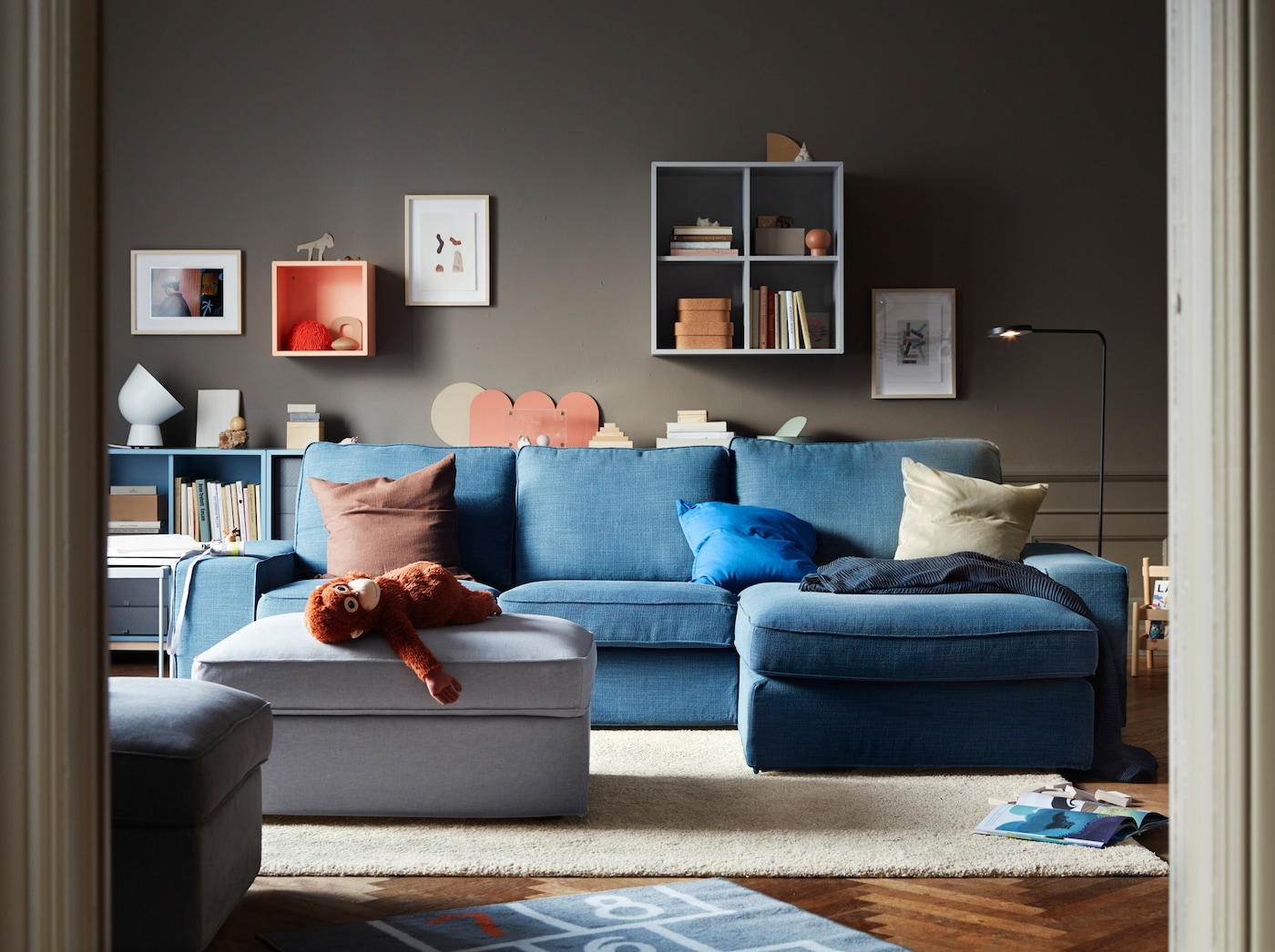 Lounge away in the living room with an IKEA KIVIK blue 3-seat sofa with chaise.This couch is soft with lots of cushions for back support.