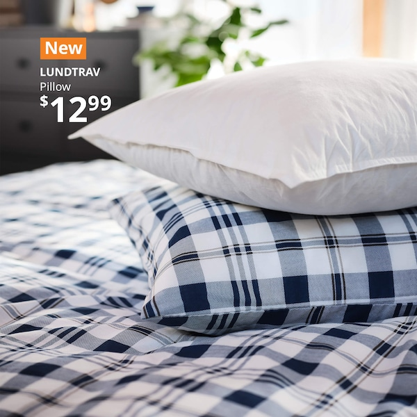 LUNDTRAV pillow stacked on a bed, leading to the Bedrooms landing page.