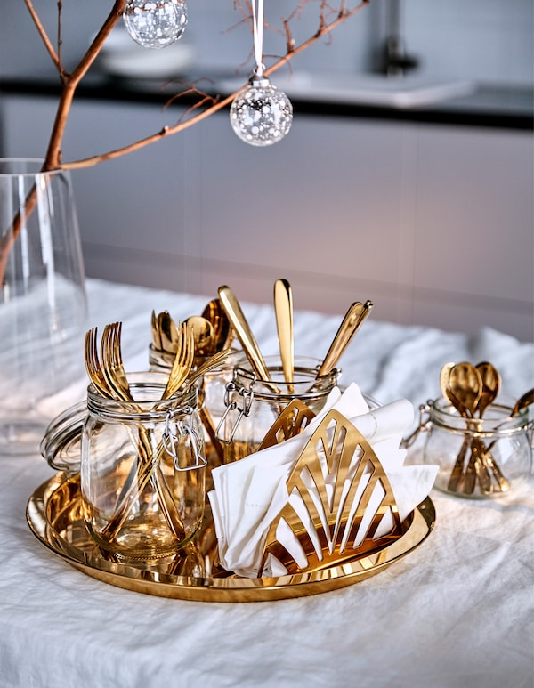 Make holiday dinner time fuss free with a party tray with cutlery. IKEA has a lot of trays such as GLATTIS brass-coloured tray in stainless steel. Carrying this tray is made easy by the protective edge, which keeps your items from sliding off.