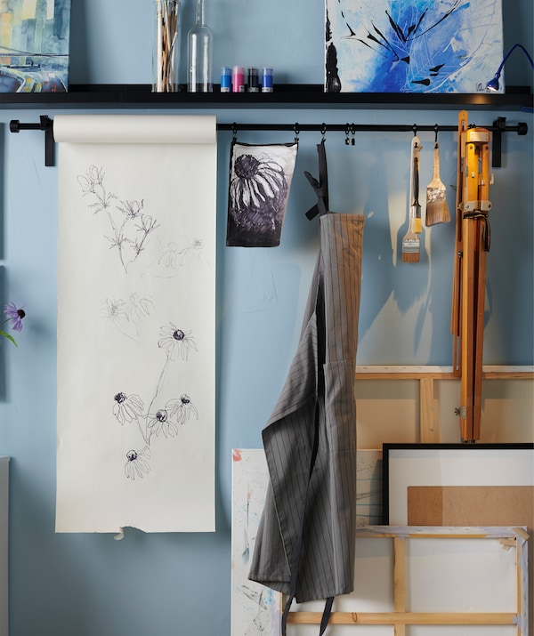 Make yourself a creative spot. Paint when you want to by using a paper roll, just pull down more paper when inspiration strikes. Try the IKEA MÅLA drawing paper roll.