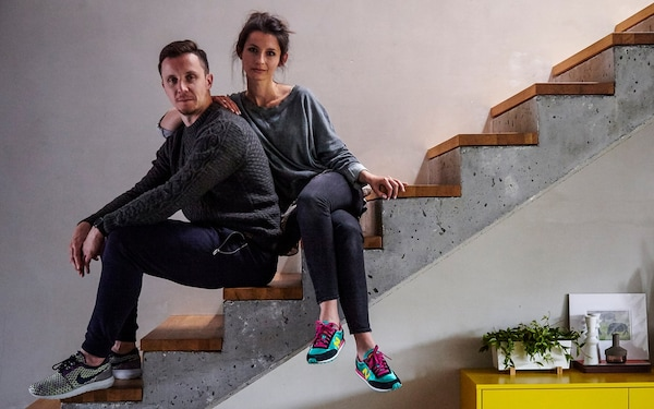 Man and woman sitting on a staircase.