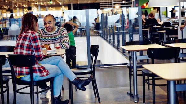 Man and women sat in an IKEA Restaurant