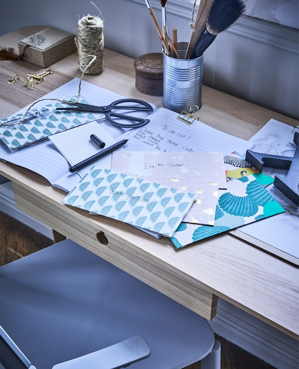 MÅNGFALD invitation cards with envelopes in a mix of patterns and colours together with a to do list on top of a desk.