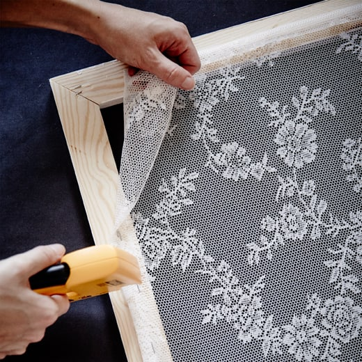 Measure out a wooden frame, then a light lacy fabric and staple in place. After that lean your textile frame in place.