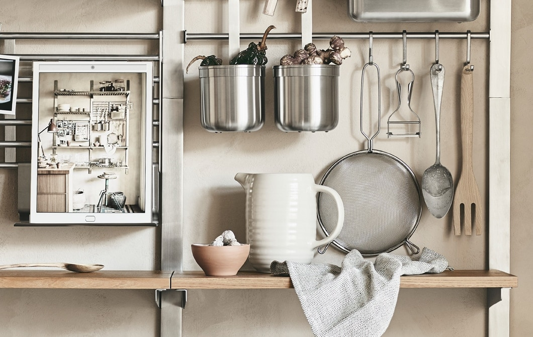 Metal rails and wooden shelves storing kitchen items.