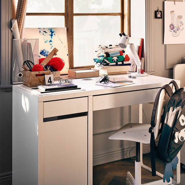 MICKE children's desk with books and other school articles on it | IKEA