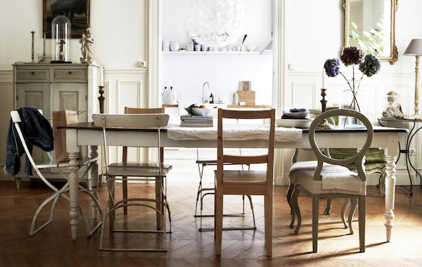 Mis-matched vintage chairs create and informal and relaxed dining area in stylist Hans Blomquist's home.