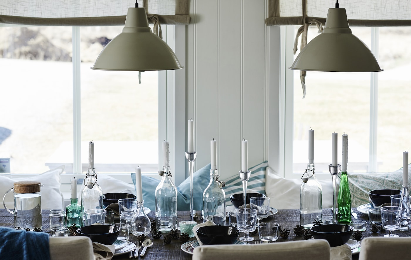 Mismatched bottles and jars make perfect candle holders at a relaxed table.