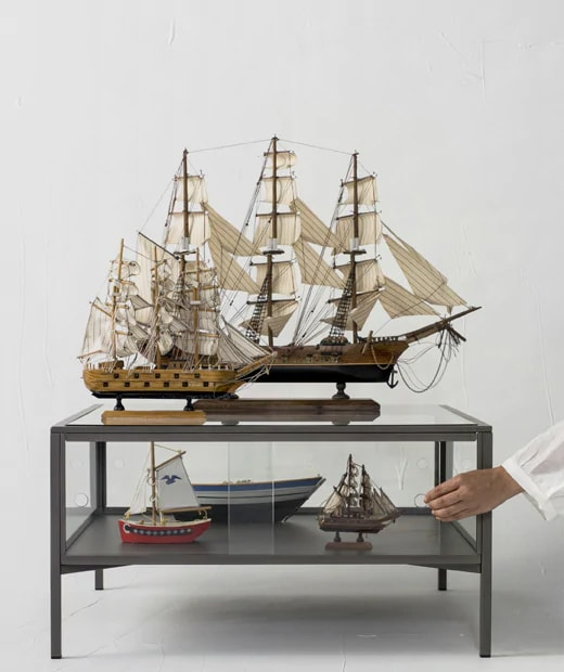 Model ships displayed on a coffee table.
