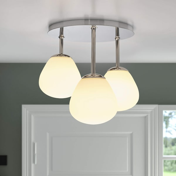 Modern light fixture with three bulbs hanging from a ceiling.