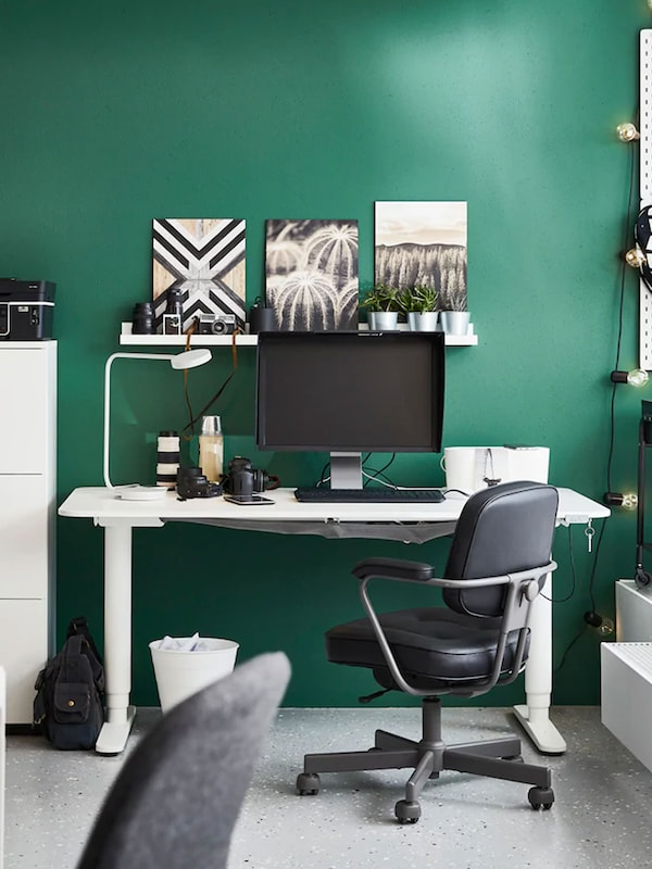 Modern styled office with white desk and black chair