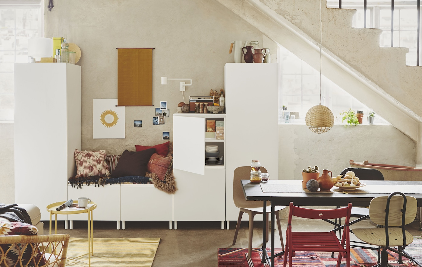Modular white storage cabinets in an open-plan home.