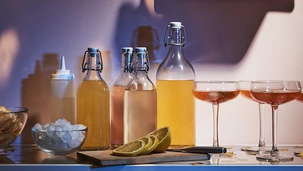Multiple KORKEN bottles filled with colorful drinks