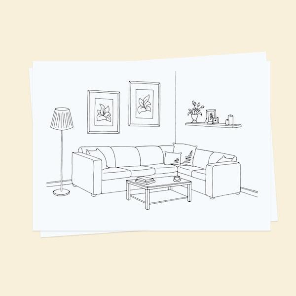 Nakreslený návrh obývacího pokoje na papíru.