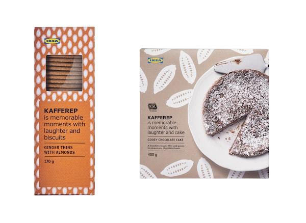 Narančasta kutija s keksima i smeđa kutija s čokoladnom tortom sprijeda.