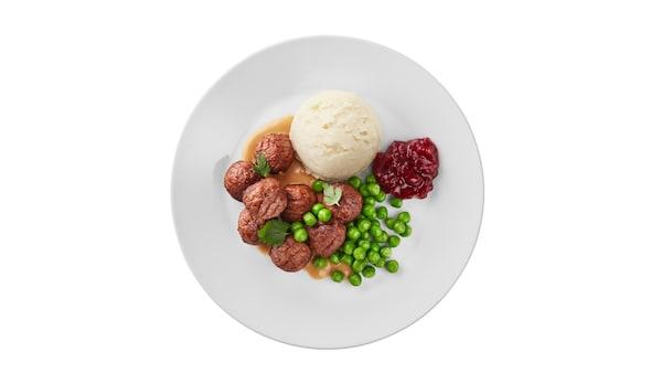 Neu: 10 Erbsenproteinbällchen mit Rahmsauce, Kartoffelstock, Erbsen und Preiselbeerkonfitüre