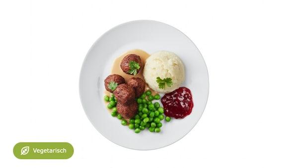 Neu: 5 Erbsenproteinbällchen mit Rahmsauce, Kartoffelstock, Erbsen inkl. Softdrink & Überraschung