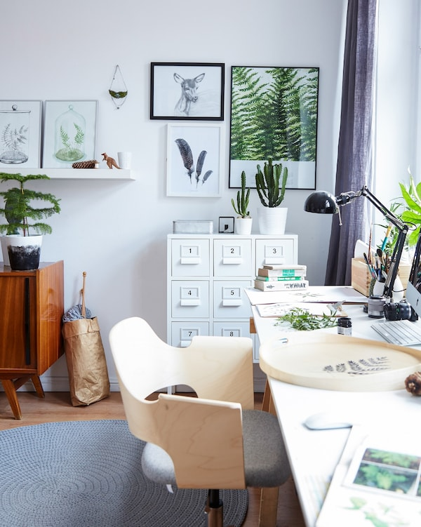 Neutral colours and natural wood create a sense of calm in this home office space that's part of the bedroom.