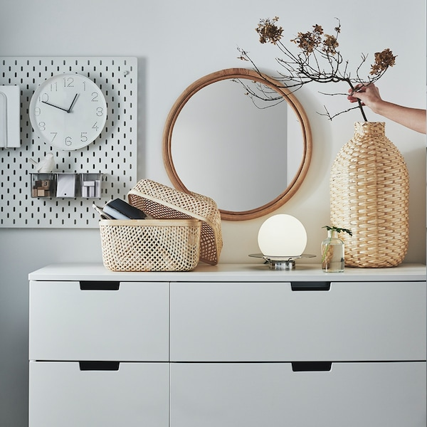 NORDLI chest of drawers with bamboo accessories.
