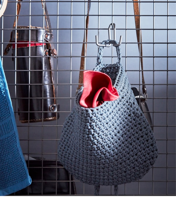 NORDRANA baskets are plastic woven with handles, so you can hang them like on this wire mesh room divider. IKEA has a variety of storage boxes and baskets that you can keep in your room and carry to the bathroom, too.