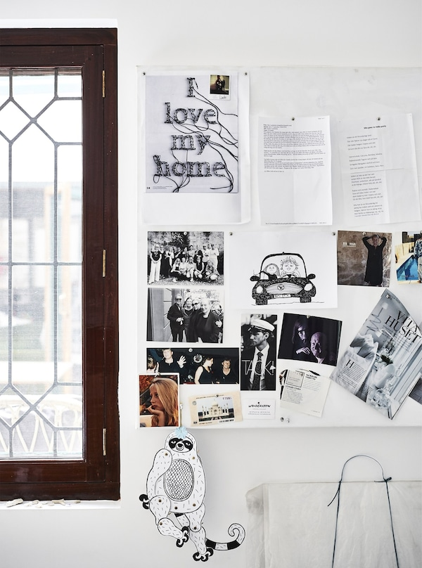 Notes, pictures and photographs on a pinboard.