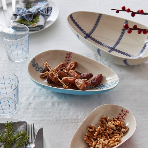 Nuts and dates are placed in three VÄRMER bowls which are shaped like avocados.