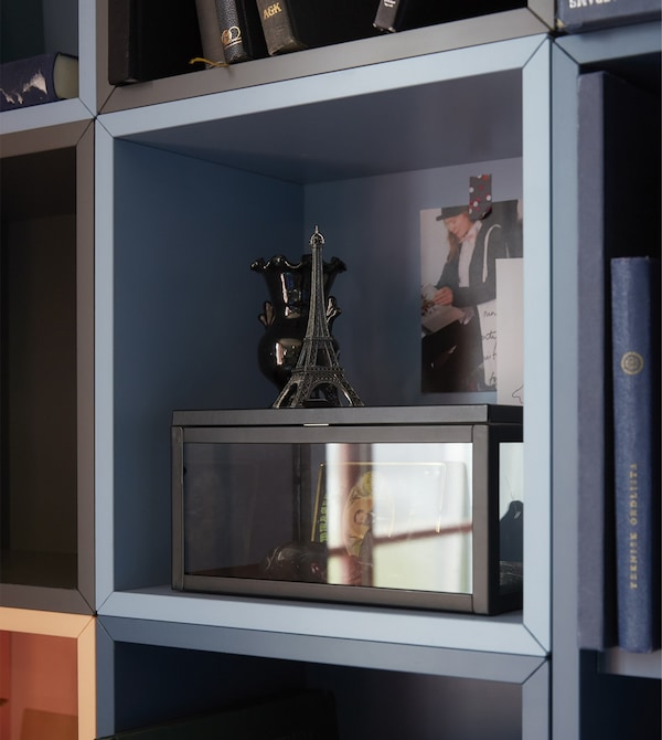 Open cabinets like EKET cabinet from IKEA can help frame your mementoes as focal points.