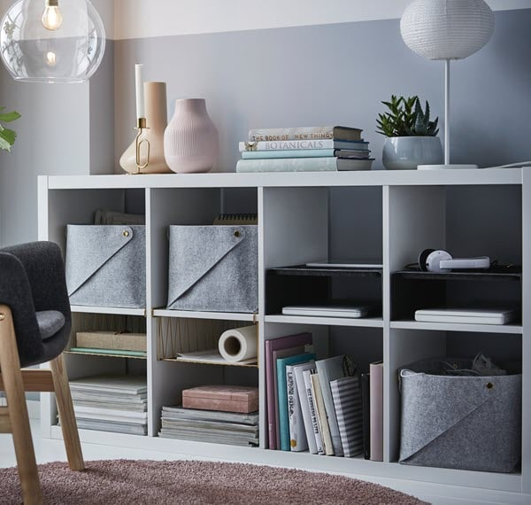 open shelving units with many partitions are easy to organize without mixing things up.