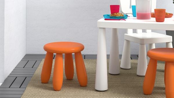 Orange MAMMUT childrens stool with other MAMMUT furniture