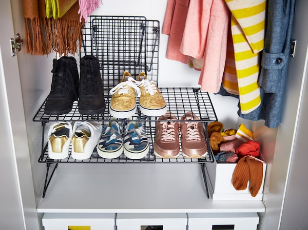 Organise shoes and closets with IKEA GREJIG foldable black shoe rack. Stack up to three levels of the sturdy netted shelves and fold them to store away.
