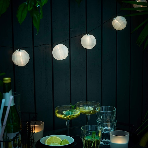 Outdoor LED lights above a patio dining table