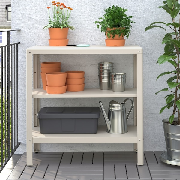 Outdoor metal shelving unit with pots, plants and a watering can