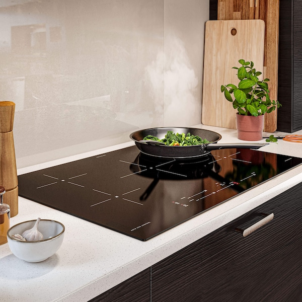 Pan with food cooking on an induction cooktop