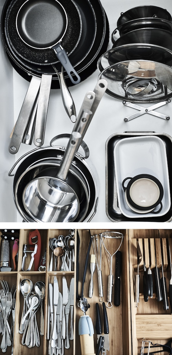 Pans and lids stacked in a drawer.