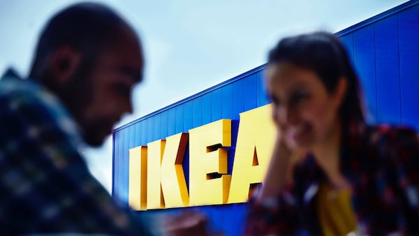 People talking in front of IKEA sign