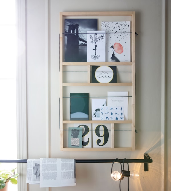 Personalise your workout space and boost motivation! Create a wall collage so that you are surrounded by the things you love. Try IKEA YPPERLIG wall shelf in solid birch.