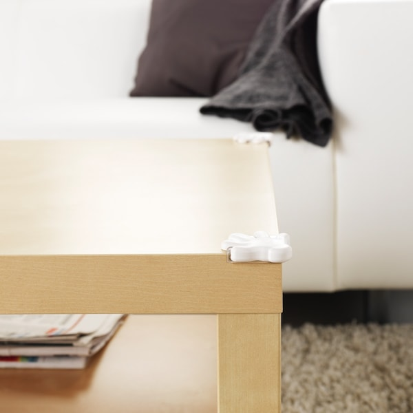 Photograph of white patrull corner bumper on a tabletop corner