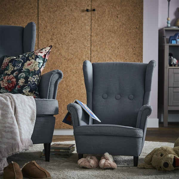 Picture of a STRANDMON wingback armchair and a child-size version alongside it.
