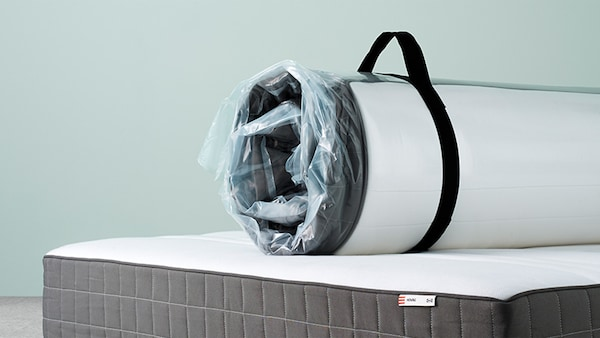 Picture of a wrapped mattess ready to be taken home, on top of a mattress
