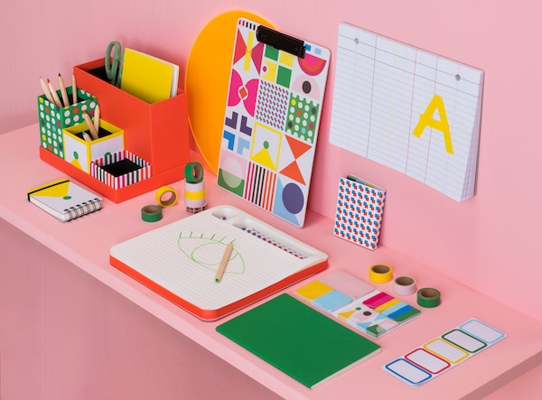 Pink wall and desk with KNALLGUL stationery series.