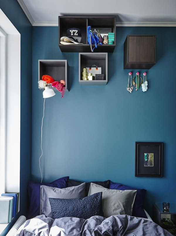 Place wall storage boxes high up on your wall to easily create out-of-the-way storage and display spaces.