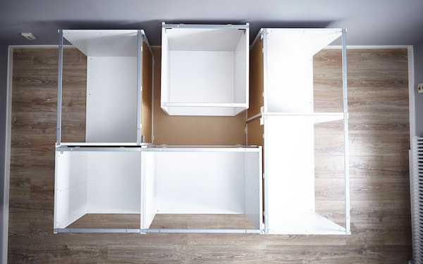 Place your METOD cabinets on your base facing outwards. We've used 2 at the front, 2 on the right side and one for each of the other sides. Because this bed is up against a wall the side facing the wall only needs one cabinet (for support).