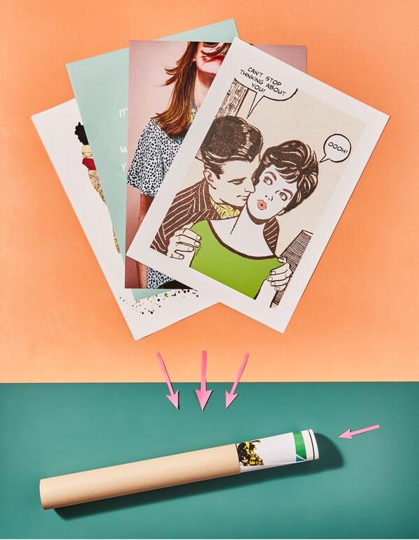 """Plakate, u. a. BILD Bild mit Motiv """"Kann nicht aufhören"""", werden in einer Papprolle gerollt."""