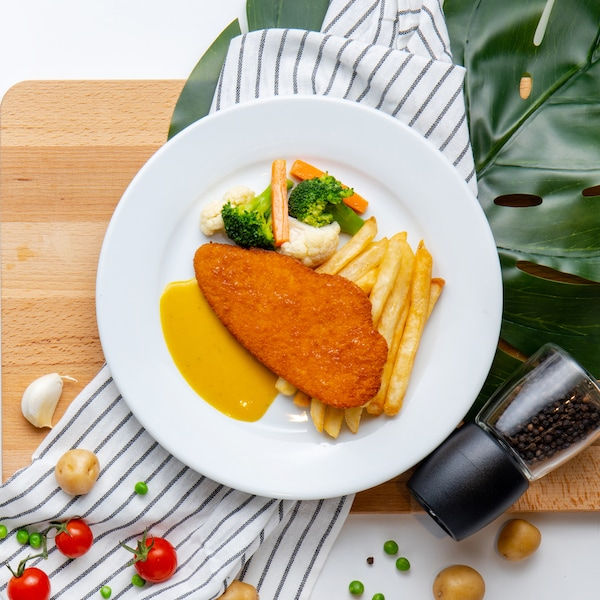 Plant-based Schnitzel with Mustard Dill Sauce, Fries & Mixed Vegetables