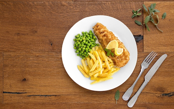 Plate with a fish, peas and fries