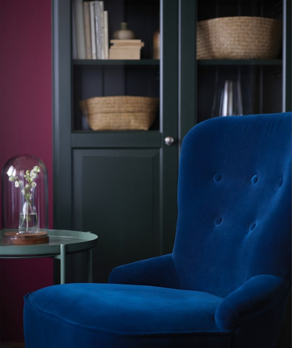Plush and soft materials like this dark blue velvet REMSTA chair from IKEA will give your living room an intimate feel this autumn.